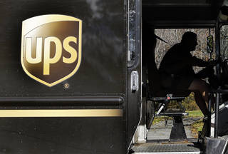A UPS driver drives after a delivery in North Andover, Mass. AP File Photo Elise Amendola - AP