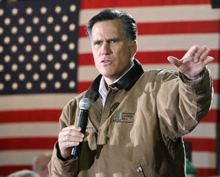 FILE - In this Dec. 12, 2011, photo, Republican presidential candidate, former Massachusetts Gov. Mitt Romney gestures during a campaign stop with mill workers at the Madison Lumber Mill in Madison, N.H. Romney is starting to open up. For the past year, the former Massachusetts governor has emphasized his business background as he argued that he should be president because he understands the economy and can fix it to help millions of out-of-work Americans. But Romney, a multimillionaire many times over who critics call robotic, has struggled to connect with average people on the campaign trail. (AP Photo/Jim Cole)