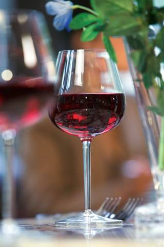 "Some of the Tuscan red wines are made solely from the region's most famous grape, sangiovese. Others blend sangiovese with international grapes including cabernet sauvignon, merlot and cabernet franc to make fuller-bodied wines that many call ""Super Tuscan"" wines. THINKSTOCK IMAGES"