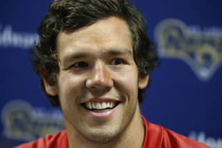 St. Louis Rams' quarterback Sam Bradford smiles during a press conference after taking part in an NFL training session at Arsenal soccer club's training facilities in London Colney, England, Wednesday, Oct. 24, 2012. The Rams are to play the New England Patriots at Wembley stadium in London, Sunday, Oct. 28 in a regular season NFL game. (AP Photo/Matt Dunham) ORG XMIT: LMD129