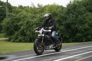 Employee Ben Lund demonstrates Harley-Davidson's new electric motorcycle at Harley's research facility in Wauwatosa, Wis. The company plans to unveil the LiveWire model Monday in New York. AP Photo M.L. Johnson -