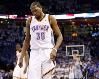 Oklahoma City's Kevin Durant (35) walks to the Memphis basket after a Thunder foul late in overtime during Game 2 in the first round of the NBA playoffs between the Oklahoma City Thunder and the Memphis Grizzlies at Chesapeake Energy Arena in Oklahoma City, Monday, April 21, 2014. Memphis won 111-105 in overtime. Photo by Nate Billings, The Oklahoman