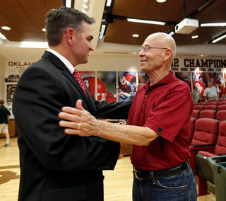 Former baseball head coach Larry Cochell, right, greets Pete Hughes after he is introduced as the University of Oklahoma (OU) Sooners new baseball coach on Thursday, June 27, 2013 in Norman, Okla. Photo by Steve Sisney, The Oklahoman