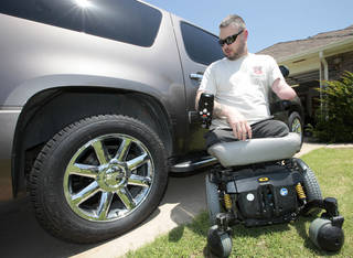 Rusty Dunagan, 33, of Edmond, lost two legs and an arm in Afghanistan, and then had his customized SUV burglarized over the weekend, Wednesday, June 12, 2013. Photo by David McDaniel, The Oklahoman David McDaniel - The Oklahoman