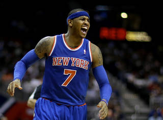 New York Knicks' Carmelo Anthony yells out looking for a foul call from the officials after missing a shot in the fourth quarter of an NBA basketball game against the Atlanta Hawks, Wednesday, April 3, 2013, in Atlanta. New York won 95-82. (AP Photo/David Goldman) ORG XMIT: GADG108