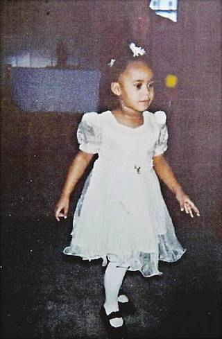 This undated photo shows Precious Doe, a little girl whose headless body was found along a road in Kansas City in 2001. She was identified in 2005 as Erica Michelle Marie Green. Her photo was released by Muskogee police. Her father is suing officials at DHS and the state Corrections Department. AP