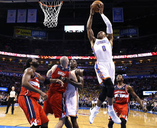 Oklahoma City's Russell Westbrook (0) shoots a lay up during the NBA game between the Oklahoma City Thunder and the Washington Wizards at the Chesapeake Energy Arena, Sunday, Nov. 10, 2013. Photo by Sarah Phipps, The Oklahoman