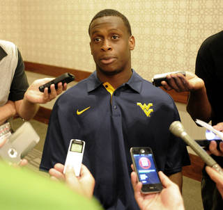 West Virginia quarterback Geno Smith answers questions during the Big 12 Conference NCAA college football media days, Tuesday, July 24, 2012, in Dallas. (AP Photo/Matt Strasen) ORG XMIT: TXMS123