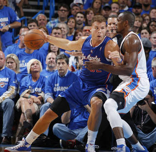 Blake Griffin (32) backs down against Serge Ibaka (9) during Game 2 of the Western Conference semifinals in the NBA playoffs between the Oklahoma City Thunder and the Los Angeles Clippers at Chesapeake Energy Arena in Oklahoma City, Wednesday, May 7, 2014. Photo by Bryan Terry, The Oklahoman