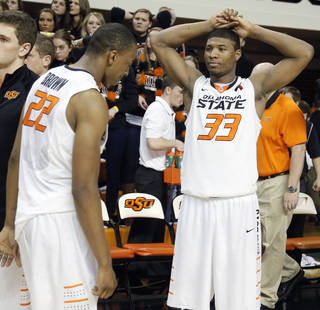 REACTION: Oklahoma State's Marcus Smart (33) and Markel Brown (22) react after the 68-67 double overtime loss to Kansas during the college basketball game between the Oklahoma State University Cowboys (OSU) and the University of Kansas Jayhawks (KU) at Gallagher-Iba Arena on Wednesday, Feb. 20, 2013, in Stillwater, Okla. Photo by Chris Landsberger, The Oklahoman