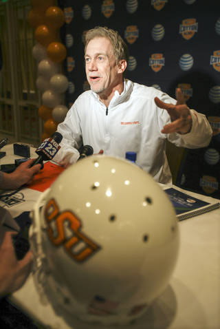 Oklahoma State defensive coordinator Glenn Spencer talks to reporters during an NCAA college football game news conference Tuesday, Dec. 31, 2013, in Irving, Texas. Oklahoma State plays Missouri in the Cotton Bowl on Friday. (AP Photo/Tim Sharp) Tim Sharp -