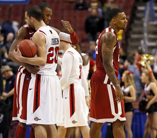 Oklahoma's Amath M'Baye (22) hugs San Diego State's JJ O'Brien (20) as Oklahoma's Romero Osby (24) walks away after a game between the University of Oklahoma and San Diego State in the second round of the NCAA men's college basketball tournament at the Wells Fargo Center in Philadelphia, Friday, March 22, 2013. San Diego State beat OU, 70-55. Photo by Nate Billings, The Oklahoman