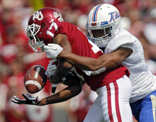 TULSA GOLDEN HURRICANE: Tulsa 's Dwight Dobbins (9) breaks up a pass for Oklahoma's Trey Metoyer (17) during the college football game between the University of Oklahoma Sooners (OU) and the University of Tulsa Hurricane (TU) at the Gaylord Family-Oklahoma Memorial Stadium on Saturday, Sept. 14, 2013 in Norman, Okla. Photo by Chris Landsberger, The Oklahoman