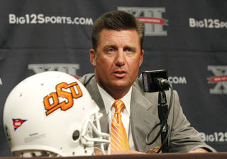 Oklahoma State University football coach Mike Gundy addresses the media at the beginning of the Big 12 Conference Football Media Days Monday, July 22, 2013 in Dallas. (AP Photo/Tim Sharp) ORG XMIT: TXTS103