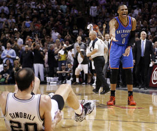 Oklahoma City's Russell Westbrook (0) argues after being called for a foul as San Antonio's Manu Ginobili (20) falls to the ground during Game 2 of the Western Conference Finals in the NBA playoffs between the Oklahoma City Thunder and the San Antonio Spurs at the AT&T Center in San Antonio, Wednesday, May 21, 2014. Photo by Sarah Phipps