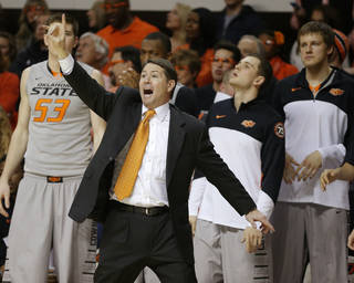 Oklahoma State Travis Ford shouts instructions during an NCAA college basketball game between Oklahoma State University (OSU) and the University of Kansas at Gallagher-Iba Arena in Stillwater, Okla., Saturday, March 1, 2014. Oklahoma State won 72-65. Photo by Bryan Terry, The Oklahoman