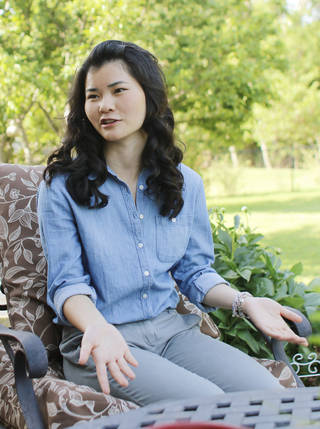 Abbey Grace White, 17, who was adopted from a Chinese orphanage, plans to return to China during a summer trip to help orphans. Photo by Doug Hoke, The Oklahoman DOUG HOKE