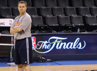 Thunder coach Scott Brooks stands at mid court as he watches his players go through drills during the NBA Finals practice day at the Chesapeake Energy Arena on Monday, June 11, 2012, in Oklahoma City, Okla. Photo by Chris Landsberger, The Oklahoman