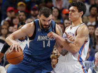 OKC' Steven Adams, right, defends against Minnesota's Nikola Pekovic during the Thunder's 113-103 win on Sunday. With the win, the Thunder completed a season-high six-game homestand. Photo by Sarah Phipps, The Oklahoman