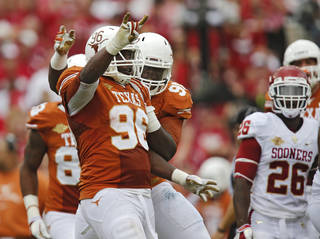 UT's Chris Whaley (96) celebrates his touchdown on an interception return during the Red River Rivalry college football game between the University of Oklahoma Sooners (OU) and the University of Texas Longhorns (UT) at the Cotton Bowl Stadium in Dallas, Saturday, Oct. 12, 2013. Photo by Chris Landsberger, The Oklahoman