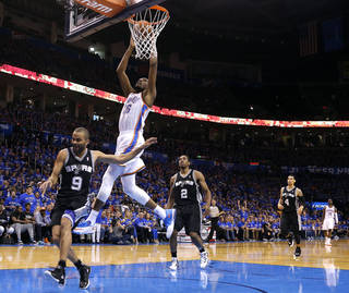 Oklahoma City's Kevin Durant (35) dunks in front of San Antonio's Tony Parker (9) during Game 3 of the Western Conference Finals in the NBA playoffs between the Oklahoma City Thunder and the San Antonio Spurs at Chesapeake Energy Arena in Oklahoma City, Sunday, May 25, 2014. Photo by Bryan Terry, The Oklahoman