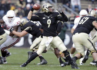 Purdue quarterback Robert Marve throws against Indiana during the first half of an NCAA college football game in West Lafayette, Ind., Saturday, Nov. 24, 2012. (AP Photo/Michael Conroy) ORG XMIT: INMC107