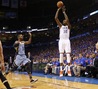 Oklahoma City's Kevin Durant (35) shoots over Memphis' Mike Conley (11) during Game 7 in the first round of the NBA playoffs between the Oklahoma City Thunder and the Memphis Grizzlies at Chesapeake Energy Arena in Oklahoma City, Saturday, May 3, 2014. Photo by Nate Billings, The Oklahoman