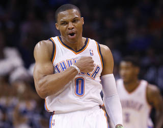 Oklahoma City Thunder guard Russell Westbrook (0) gestures following a 3-point basket in the second quarter of an NBA basketball game against the Philadelphia 76ers in Oklahoma City, Tuesday, March 4, 2014. (AP Photo/Sue Ogrocki)