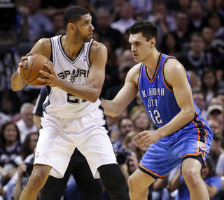 San Antonio's Tim Duncan (21) keeps the ball away from Oklahoma City's Steven Adams (12) during Game 5 of the Western Conference Finals in the NBA playoffs between the Oklahoma City Thunder and the San Antonio Spurs at the AT&T Center in San Antonio, Thursday, May 29, 2014. Photo by Sarah Phipps, The Oklahoman
