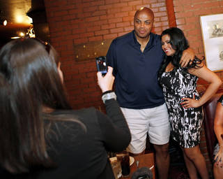 Ashley Jiron, of Oklahoma City, has her photo taken with Charles Barkley at Cattlemen's Steakhouse in Oklahoma City, Friday, June 1, 2012. Barkley was at Cattlemen's as part of a tour of Oklahoma City. Photo by Nate Billings, The Oklahoman