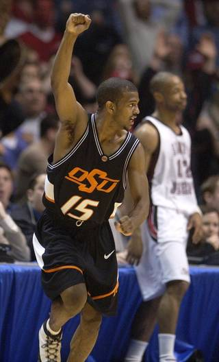 COLLEGE BASKETBALL, OSU, OKLAHOMA STATE UNIVERSITY: Oklahoma State's John Lucas (15) reacts to scoring the winning 3-point shot as Saint Joseph's Tyrone Braley (12) looks on during second half game action at the NCAA Regional final in East Rutherford, N.J., Saturday, March 27, 2004. Oklahoma State defeated Saint Joseph's 64-62. (AP Photo/Al Behrman)