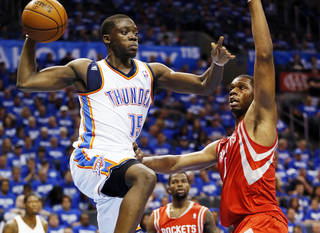 NBA BASKETBALL: Oklahoma City's Reggie Jackson (15) passes away from Houston's Terrence Jones (6) during Game 1 in the first round of the NBA playoffs between the Oklahoma City Thunder and the Houston Rockets at Chesapeake Energy Arena in Oklahoma City, Sunday, April 21, 2013. Oklahoma City won, 120-91. Photo by Nate Billings, The Oklahoman