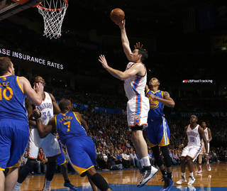 Oklahoma City's Nick Collison (4) puts up a shot beside Golden State's Kent Bazemore (20) during an NBA basketball game between the Oklahoma City Thunder and the Golden State Warriors at Chesapeake Energy Arena in Oklahoma City, Wednesday, Feb. 6, 2013. Photo by Bryan Terry, The Oklahoman