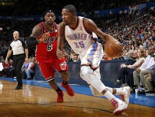 Oklahoma City's Kevin Durant (35) goes past Miami's LeBron James (6) during an NBA basketball game between the Oklahoma City Thunder and the Miami Heat at Chesapeake Energy Arena in Oklahoma City, Thursday, Feb. 15, 2013. Photo by Bryan Terry, The Oklahoman