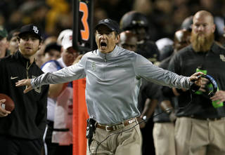 Baylor head coach Art Briles shouts in the direction of an official after a defensive penalty against Oklahoma was waved late in the second half of an NCAA college football game, Thursday, Nov. 7, 2013, in Waco, Texas. Baylor won 41-12. (AP Photo/Tony Gutierrez)