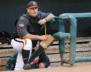 Oklahoma State coach Josh Holliday watches from the dugout during a Bedlam baseball game between the University of Oklahoma and Oklahoma State University at Chickasaw Bricktown Ballpark in Oklahoma City, Thursday, May 15, 2014. Photo by Bryan Terry, The Oklahoman