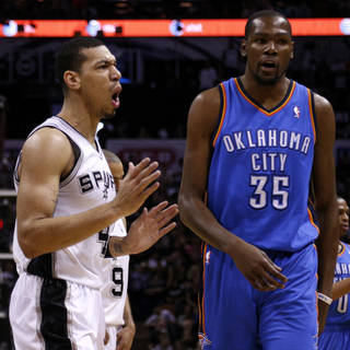 San Antonio's Danny Green (4) reacts next to Oklahoma City's Kevin Durant (35) during Game 2 of the Western Conference Finals in the NBA playoffs between the Oklahoma City Thunder and the San Antonio Spurs at the AT&T Center in San Antonio, Wednesday, May 21, 2014. Photo by Sarah Phipps, The Oklahoman