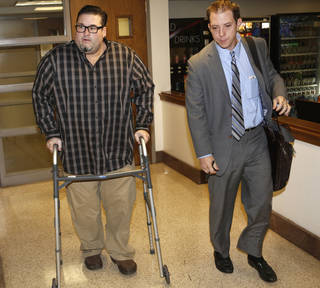 Bryan Abrams, left, the former Color Me Badd singer, and his attorney, Matt Swain, exit Judge Jequita H. Napoli's courtroom in the Cleveland County Courthouse Wednesday in Norman. Steve Gooch - AP