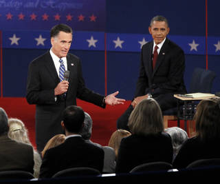 President Barack Obama, right, listens as Republican presidential candidate former Massachusetts Gov. Mitt Romney answers a question from a member of the audience during the second presidential debate at Hofstra University, Tuesday, Oct. 16, 2012 in Hempstead, N.Y. (AP Photo/Mary Altaffer) ORG XMIT: NYMA113