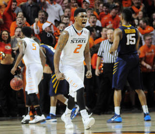 The Cowboys' Le'Bryan Nash celebrates a dunk during Saturday's victory against West Virginia. Photo by KT King, The Oklahoman