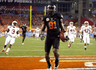 COLLEGE FOOTBALL / CELEBRATION: Oklahoma State's Justin Blackmon (81) celebrates a touchdown during the Fiesta Bowl between the Oklahoma State University Cowboys (OSU) and the Stanford Cardinals at the University of Phoenix Stadium in Glendale, Ariz., Monday, Jan. 2, 2012. Photo by Sarah Phipps, The Oklahoman