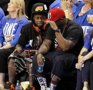 Rapper Lil Wayne sits courtside during Game 1 of the NBA Finals in Oklahoma City June 12, 2012. Photo by Nate Billings