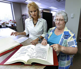 Cleveland County Clerk Tammy Belinson, left, and Deputy Clerk Jan Skelton look through county records on Friday, May 31, 2013 in Norman, Okla. Photo by Steve Sisney, The Oklahoman