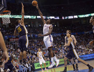 Oklahoma City Thunder's Kendrick Perkins (5) tries to get a shot over Utah Jazz's Derrick Favors (15) during the NBA basketball game between the Oklahoma City Thunder and the Utah Jazz at Chesapeake Energy Arena on Wednesday, March 13, 2013, in Oklahoma City, Okla. Photo by Chris Landsberger, The Oklahoman