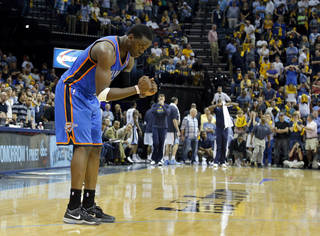 Oklahoma City's Reggie Jackson (15) reacts after Oklahoma City's win in Game 4 in the first round of the NBA playoffs between the Oklahoma City Thunder and the Memphis Grizzlies at FedExForum in Memphis, Tenn., Saturday, April 26, 2014. PHOTO BY BRYAN TERRY, The Oklahoman