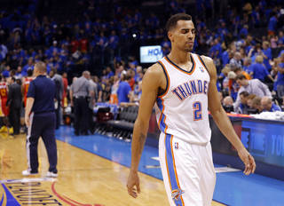 NBA BASKETBALL: Oklahoma City's Thabo Sefolosha (2) walks off the court after losing Game 5 in the first round of the NBA playoffs between the Oklahoma City Thunder and the Houston Rockets at Chesapeake Energy Arena in Oklahoma City, Wednesday, May 1, 2013. Photo by Sarah Phipps, The Oklahoman