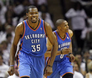 Oklahoma City's Kevin Durant (35) smiles in front of Russell Westbrook (0) after hitting a shot in the third quarter during Game 5 of the Western Conference Finals between the Oklahoma City Thunder and the San Antonio Spurs in the NBA basketball playoffs at the AT&T Center in San Antonio, Monday, June 4, 2012. The Thunder won, 108-103. Photo by Nate Billings, The Oklahoman