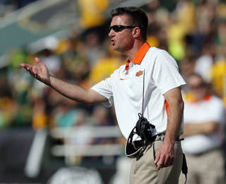 OSU head coach Mike Gundy talks to an official during a college football game between the Oklahoma State University Cowboys (OSU) and the Baylor University Bears at Floyd Casey Stadium in Waco, Texas, Saturday, Dec. 1, 2012. Photo by Nate Billings, The Oklahoman