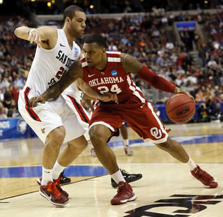 Oklahoma's Romero Osby (24) works against San Diego State's JJ O'Brien (20) during a game between the University of Oklahoma and San Diego State in the second round of the NCAA men's college basketball tournament at the Wells Fargo Center in Philadelphia, Friday, March 22, 2013. Photo by Nate Billings, The Oklahoman