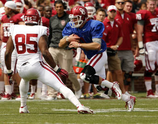 Trevor Knight, left, runs with the ball as Geneo Grissom defends during OU's spring game on Saturday. Knight had a so-so passing day, but was missing some of his experienced pass catchers. Photo by Steve Sisney, The Oklahoman